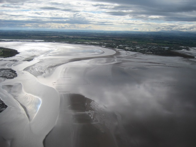 The creeks and pools on Newton Marsh; Moricambe Bay and the channel of the Wampool meandering through the sandbanks between Anthorn and Newton Arlosh
