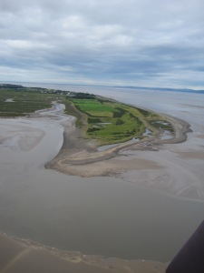 Grune Point with the town of Silloth in the distance, Skinburness Marsh to the left and on the right the Galloway coast