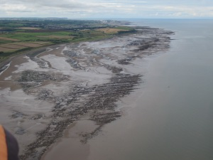 Looking South to Maryport and the wind-turbines at Siddick; the prow of St Bees' head beyond (photo: Ann Lingard)