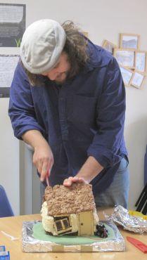Alex cuts the cake